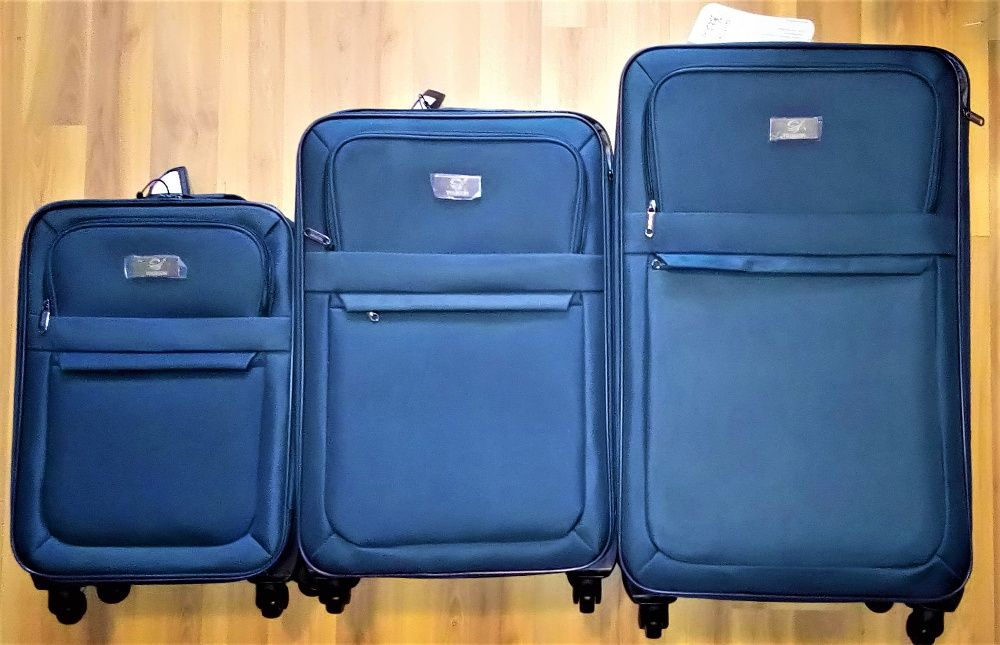 -т куфари TOURION Deluxe, 3 бр. 3 размера, 3 цифрен код, 4 колела, Тел