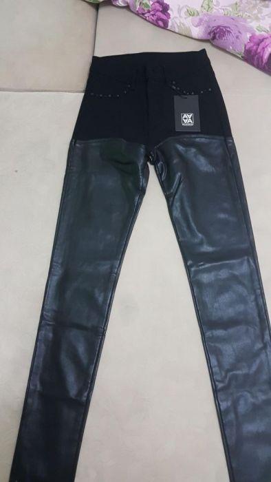 Pantaloni cu piele