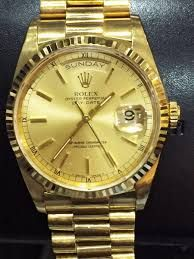 Rolex dourado