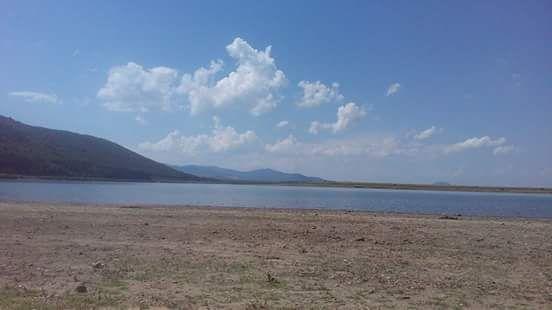 Поземлен имот до Рабишкото езеро(в регулация )