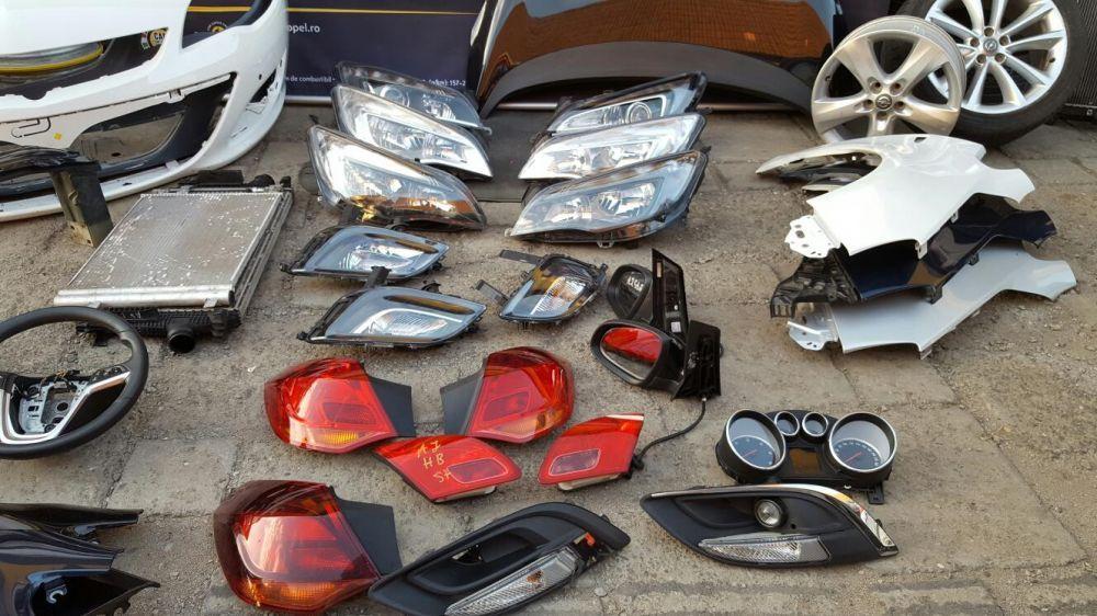 Opel Astra J, faruri, bări protecție, stopuri