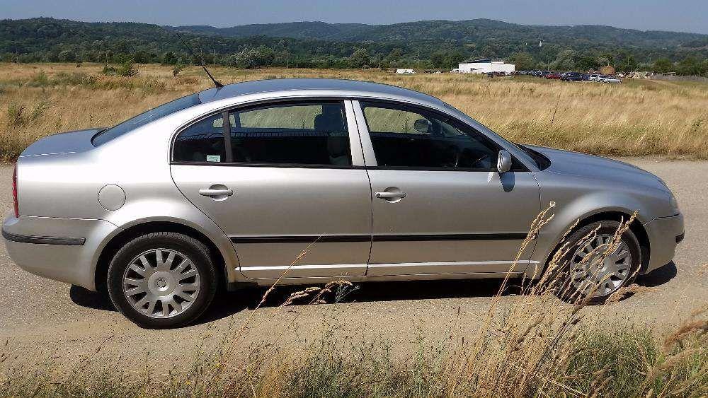 Geam mobil stanga dreapta fata spate Skoda Superb din 2003