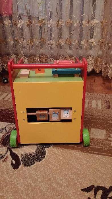 Развивающая игрушка-каталка