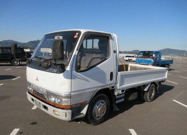 Vendo mitsubishi canter a gasolina recém chegado motor 4M40