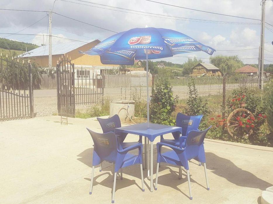set 4 scaune . masa + umbrela