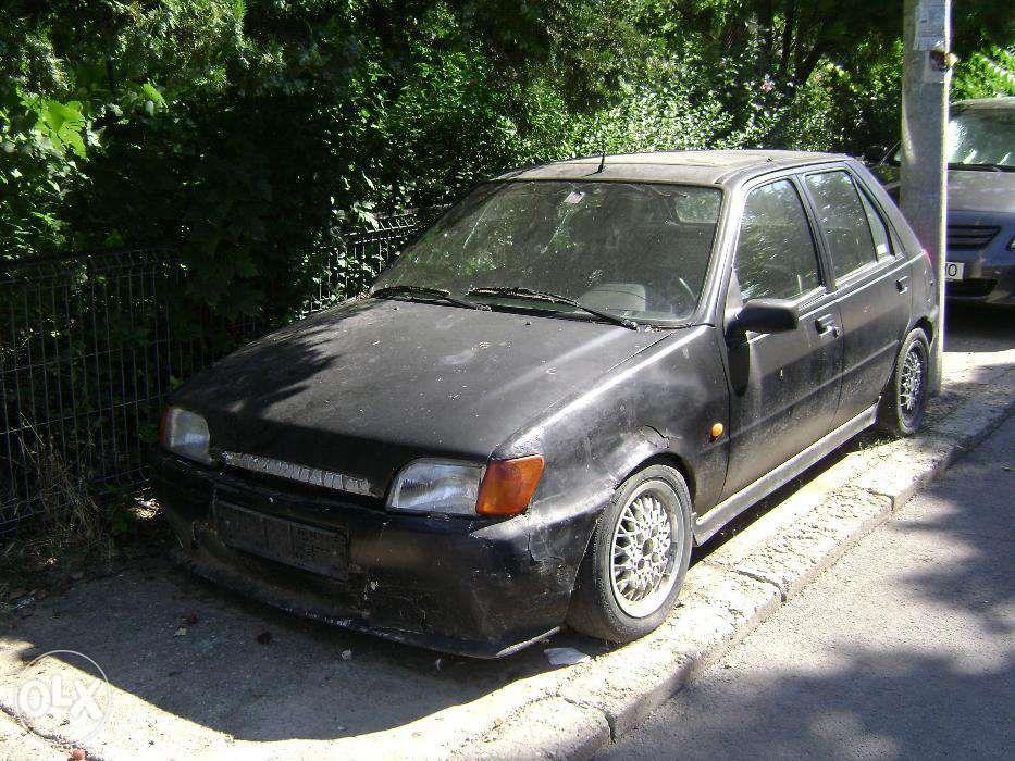 Far Ford Fiesta,faruri Ford Fiesta,stanga/dreapta,an 1989/1995