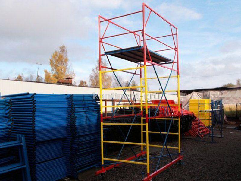 Вышка-тура на колесах для работ на высоте и строительные леса