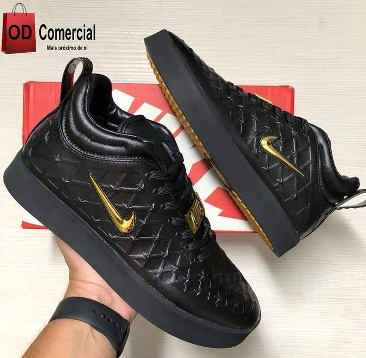 Nike temp preta e dourada