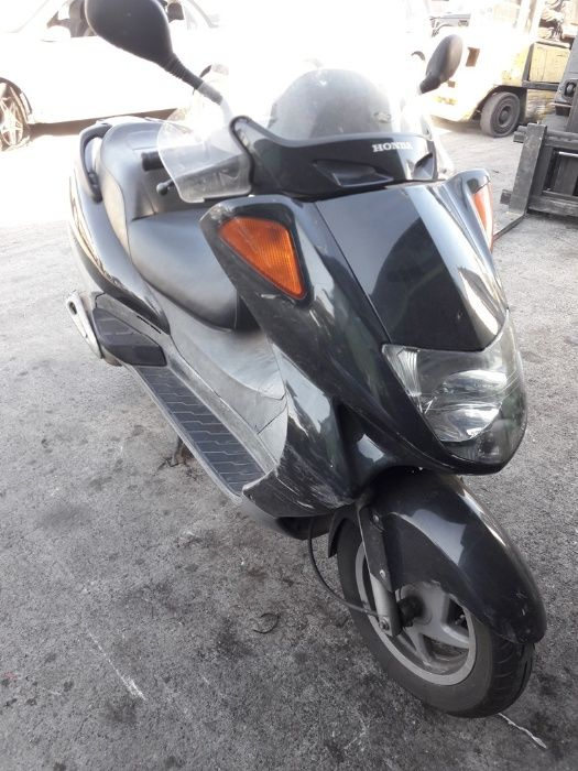 Скутер(мотоциклет)Хонда Форсайт 250Honda Foresight 250() -на части
