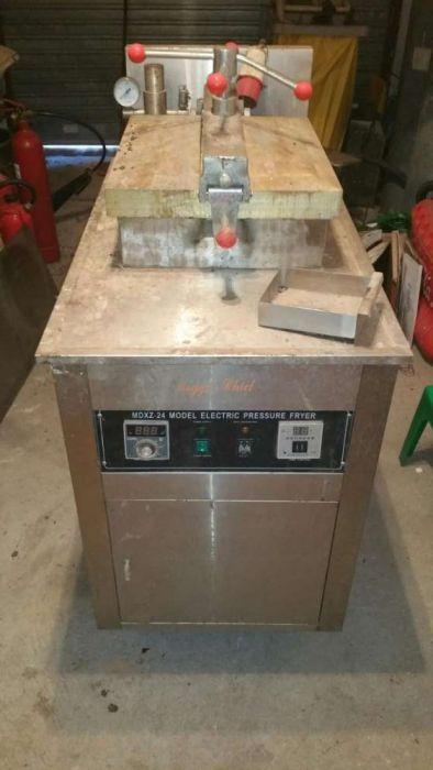 Maquina elétrica para fritar pedacos de frango a alta pressao