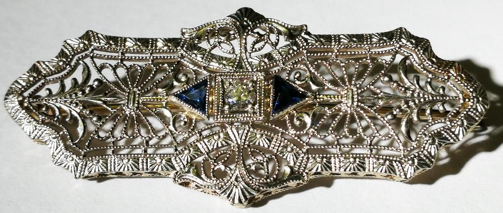 Brosa 41x18 mm art deco 3,9 grame aur alb marcat 14 k cu diamant