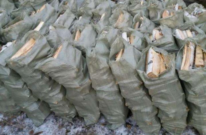 продается дрова в мешках