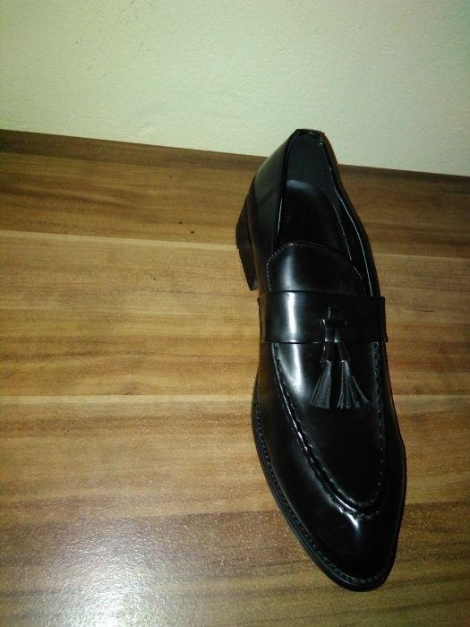 sapatos em couro...