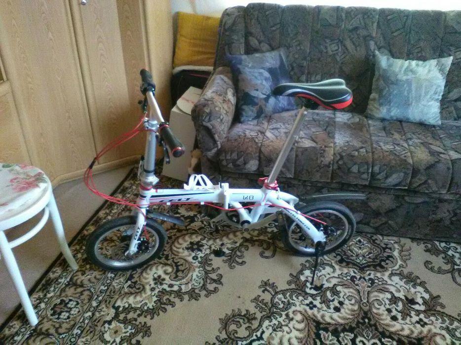 Bicicleta pliabila noua frane pe disc