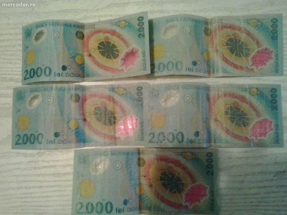 Bancnote 2000 lei cu eclipsa de soare