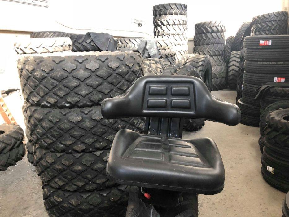Scaun universal pt tractor sau alte utilaje cu triplu reglaj pe arc
