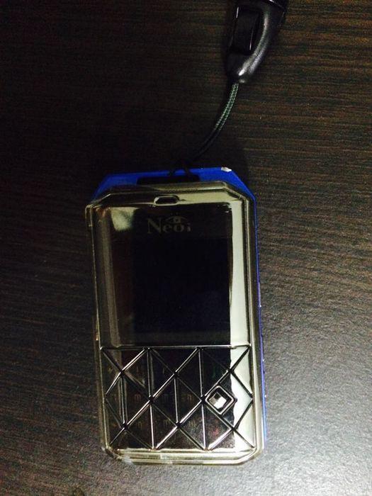 Сотовый телефон. Очень маленький