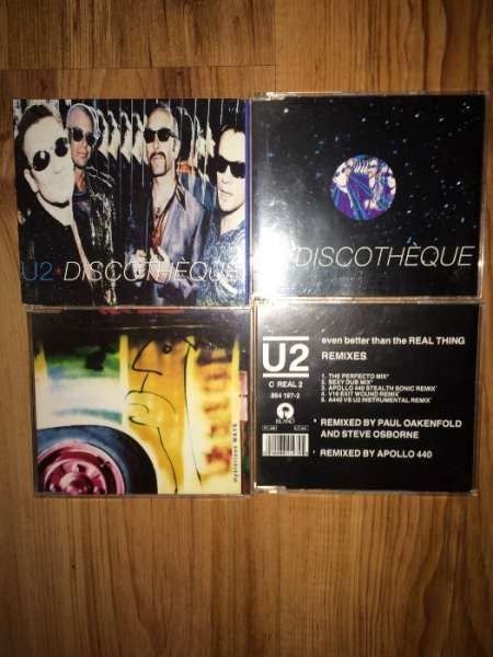 12 CD сингъла на U2