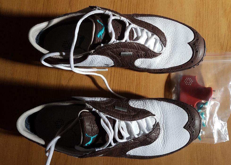 Adidas marca PUMA, crampoane de rezerva si posibil detasabile.