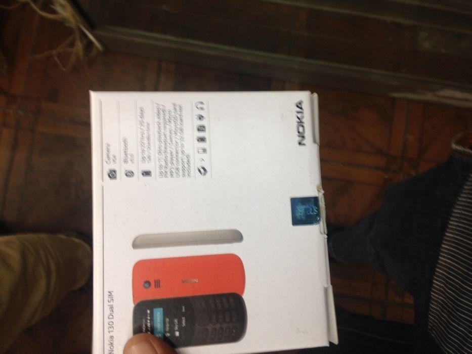 Nokia 210 na caixa, com todos acessórios