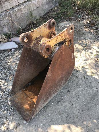 Cupa buldoexcavator caterpilar