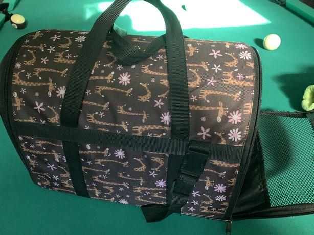 Переносную сумку для собак