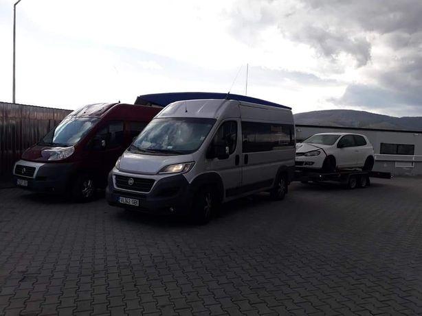 Transport masini pe platforma mobila colete persoane Germania Romania