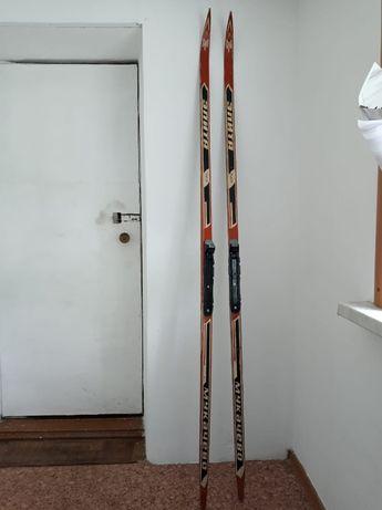Беговые лыжи с новыми креплениями без ботинок