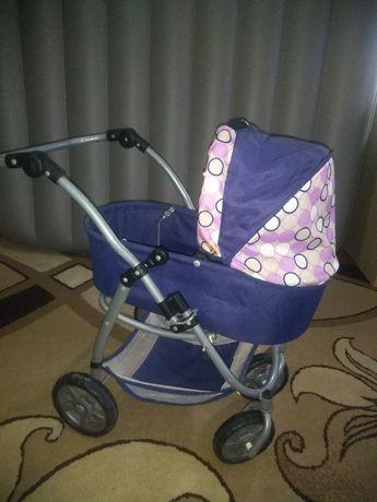 Детская игрушечная коляска