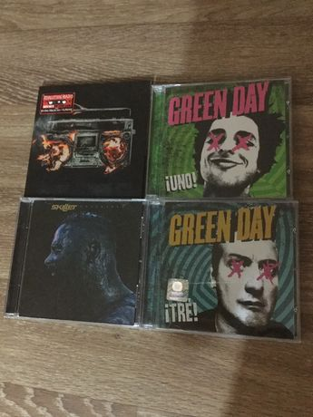 CD диски Green Day и Skillet