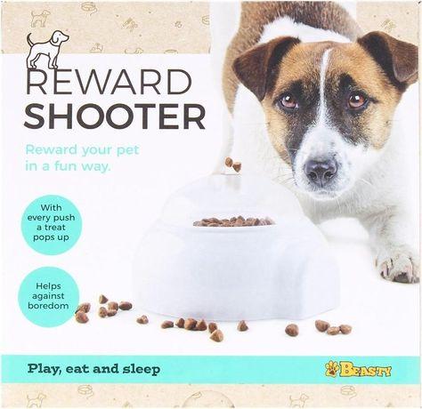 Игра за домашни любимци с изстрелване на награда.