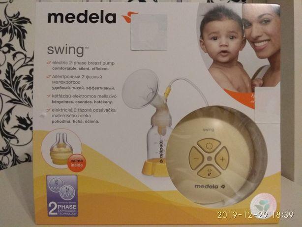 Medela электронный 2-фазный молокоотсос.