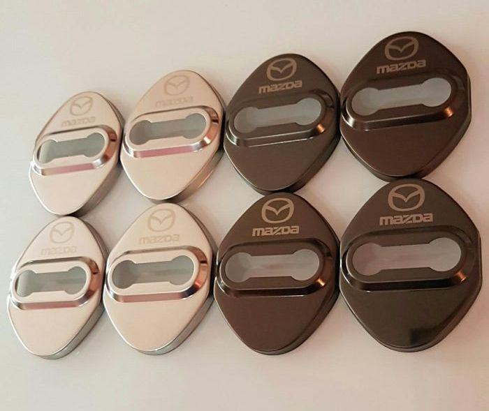 Capace protectie incuietoare usi cu logo Mazda