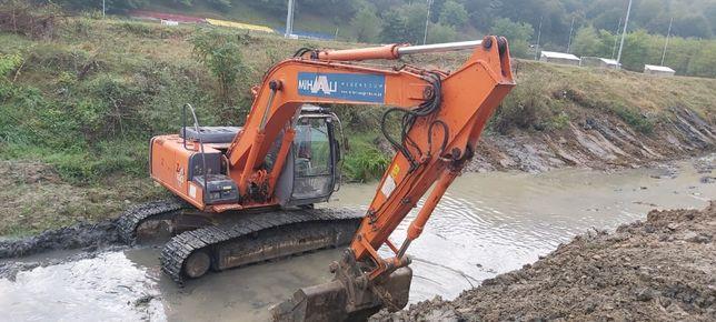 Excavator pentru decolmatări rauri, terasamente rutiere, demolări, etc