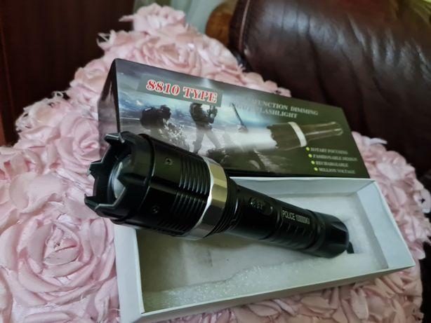 Vand electrosoc cu lanterna police 100000kw