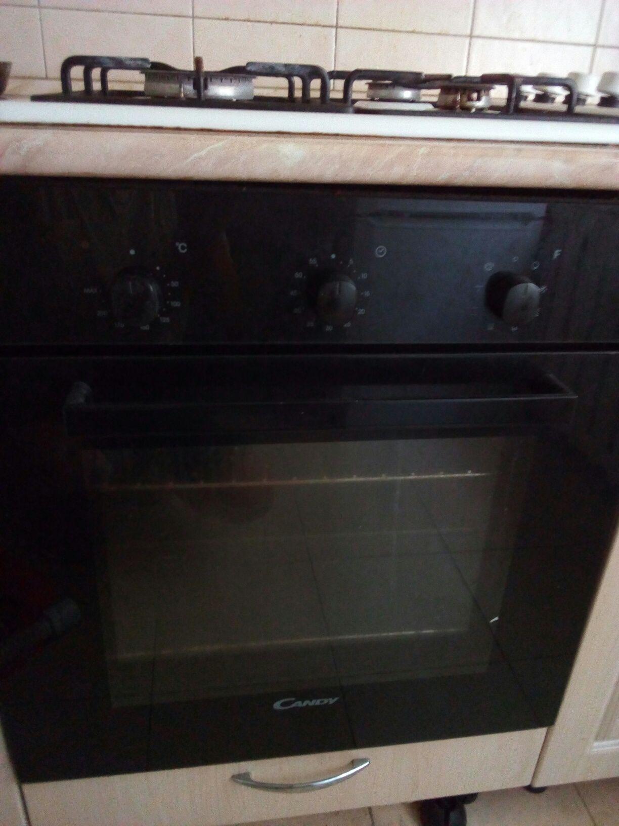Продам газ плиту с электроподжогом  с духовым шкафом электрический