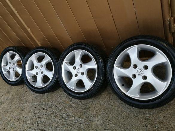 Mazda оригинални джанти 15-ски с летни гуми Bridgestone