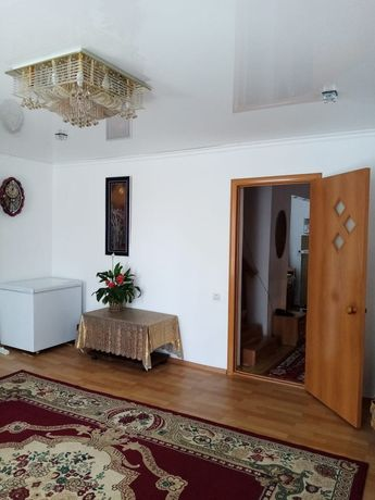 Часть двухэтажного дома
