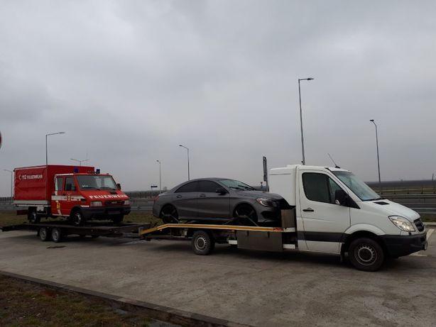 Transport auto pe platforma/slep Romania-Germania-Austria-Romania