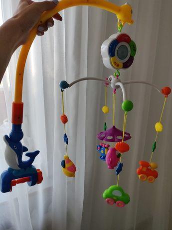 Музыкальная игрушка на детскую кроватку