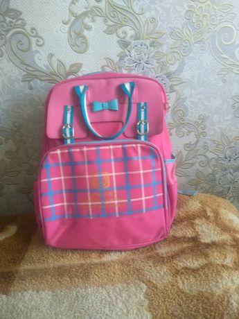 Школьный рюкзак, розового цвета.