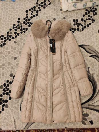 Продам женский пуховик куртку
