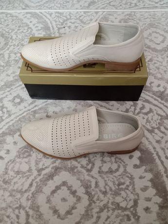 Продам новые туфли мужские