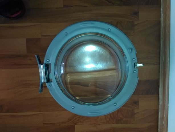 Vând ușă (hublou ) mașină de spălat rufe, marca AEG.