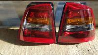 Stop lampa tripla stanga dreapta fumuriu Opel Astra G hatchback