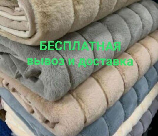 Стирка и чистка пледов и ковров в цеху.
