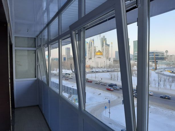 Изготовление пластиковых окон балконов установка дублирующих ветрожей.