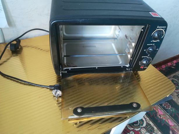 Продам почти новую мини электро печь.