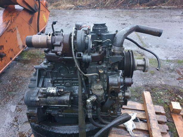Motor komatsu wb buldoexcavator
