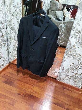 Продам детский чёрный костюм 42 размера. Производство Турция